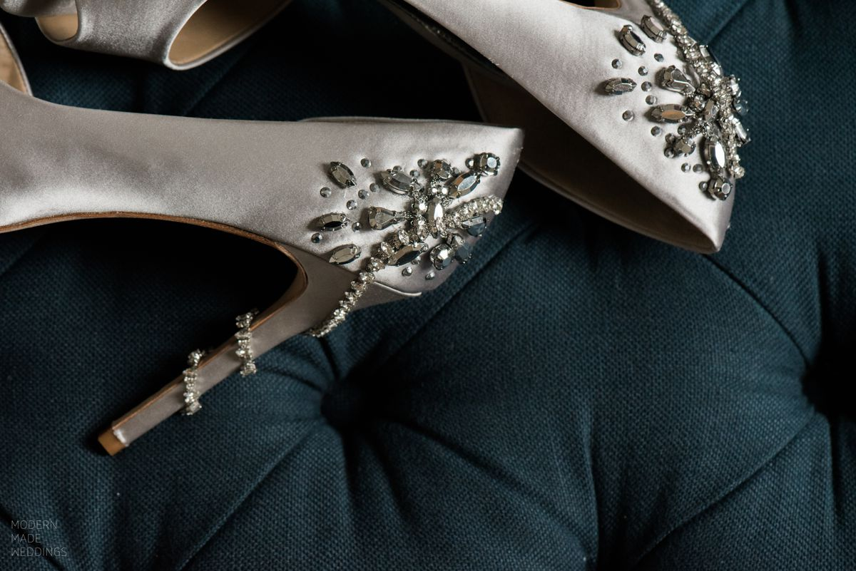 wedding shoes on navy ottoman